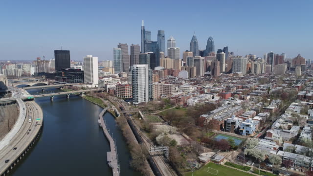 scenic view on philadelphia downtown over schuylkill river park in early springtime.  panoramic camera motion - philadelphia pennsylvania stock videos & royalty-free footage