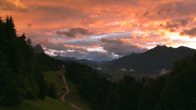 scenic view over wamberg mountain village and waxenstein mountain in the background, near sunset. - garmisch partenkirchen stock videos and b-roll footage