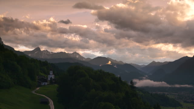 scenic view over wamberg mountain village and waxenstein mountain in the background, near sunset. - werdenfelser land stock videos and b-roll footage