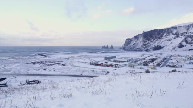 ws scenic view snow covered landscape and ocean,iceland - remote location video stock e b–roll