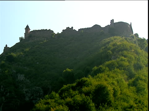 Scenic views of fortress ruins in lush green hills Jaipur