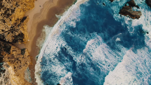 aerial ws scenic views praia da ursa beach in portugal - ledge stock videos & royalty-free footage
