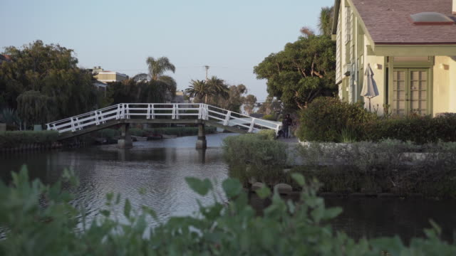 scenic wooden bridge over river, california - venice california stock videos & royalty-free footage