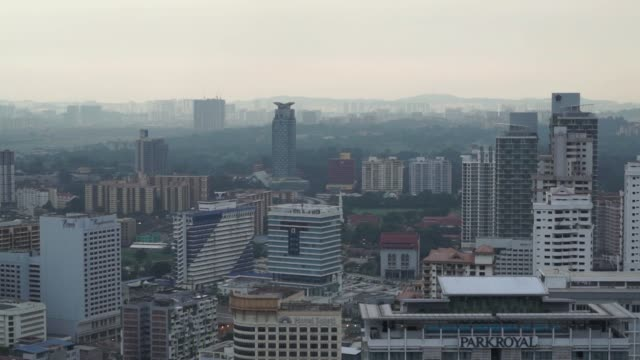 Scenics of the city of Kuala Lumpur Malaysia on September 29 2015 Shots wide cityscape tighter shot of building with two towers wide shot of...