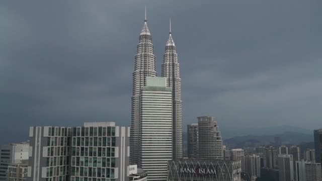 Scenics of the city of Kuala Lumpur Malaysia on September 29 2015 Shots wide shot of the petronas twin towers additional similar cityscapes including...