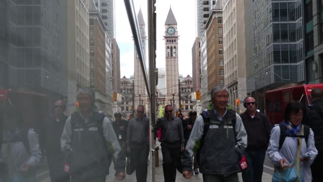 scenics of toronto's bay street/financial district in toronto ontario canada on may 19 2017 shots wide shot of intersection as people walk by shot of... - financial building stock videos and b-roll footage