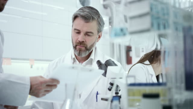 scentists in lab report the test results - medical research stock videos & royalty-free footage