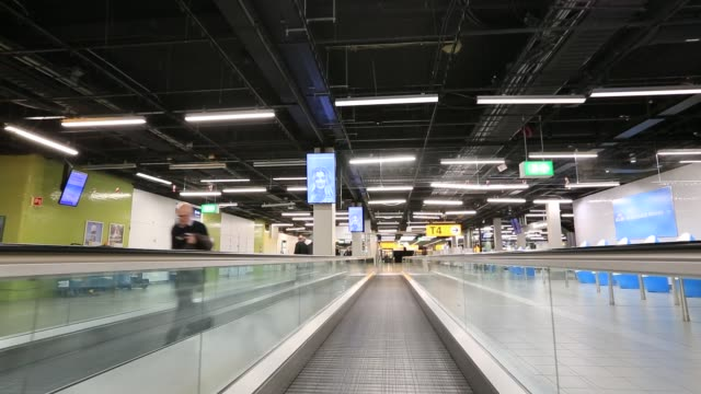 schiphol airport in amsterdam netherlands - flugpassagier stock-videos und b-roll-filmmaterial