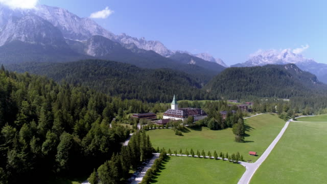 stockvideo's en b-roll-footage met schloss elmau (elmau castle) in the bavarian alps - bavarian alps