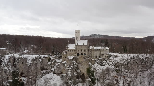 schloss lichtenstein in winter swabian alb castle lichtenstein in snow flight 4k - palace stock videos & royalty-free footage