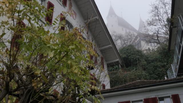 schloss thun and rathausplatz, thun, jungfrau region, bernese oberland, swiss alps, switzerland, europe - circa 12th century stock videos & royalty-free footage