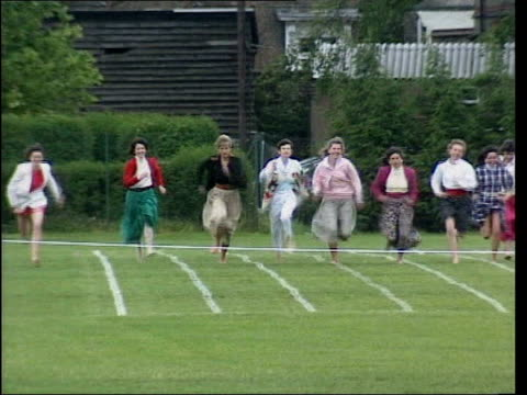 school bans egg and spoon race at sports day; lib london: richmond: princess diana running in mother's race at prince harry's school sports day - princess stock videos & royalty-free footage