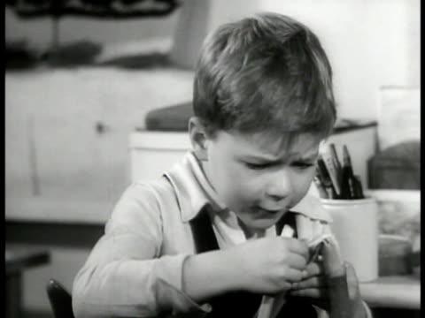 school boy describing plant to female teacher . vs young asian boy sawing wood , caucasian boy painting model theatre. cute, grade school - skill stock videos & royalty-free footage