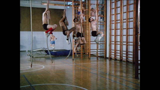 montage school boys climb ropes and ladders at gym class / uk - school building stock videos and b-roll footage