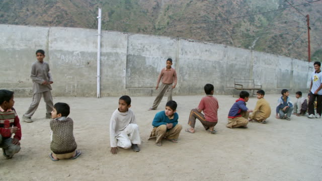 School boys playing games