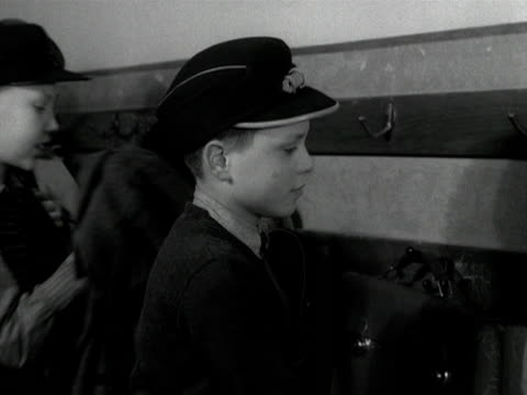 school boys put their hats and jackets on at home time. 1955. - schoolboy stock videos & royalty-free footage