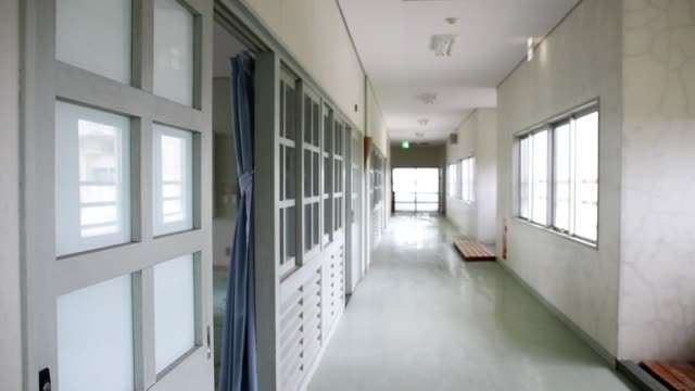 school building in a japanese school where no one is present - corridor stock videos & royalty-free footage