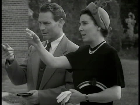 school building man woman fg ms man woman pointing at building ws members looking at field vs members pointing talking ws grass field virginia - 1947 stock videos and b-roll footage