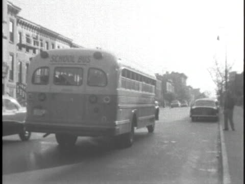 school bus carrying black students travels through a queens neighborhood. - united states and (politics or government) stock videos & royalty-free footage