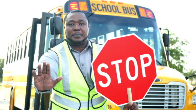 school bus, crossing guard and stop sign - bus driver stock videos & royalty-free footage