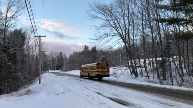 school bus driving down country road during winter in rumford, maine usa - new england usa stock videos & royalty-free footage