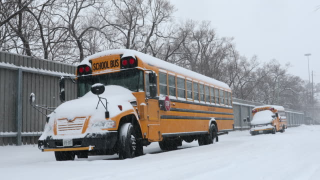 School bus on a snowy road snow