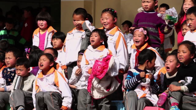 MS School children cheering for their classmate in school sports meeting AUDIO / xi'an, shaanxi, china