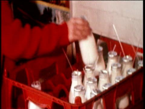 school children collect free milk from crate uk; 25 jun 71 - 1971 stock-videos und b-roll-filmmaterial