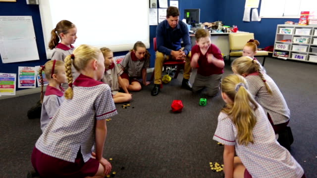school children doing maths games in the classroom - schoolgirl stock videos and b-roll footage
