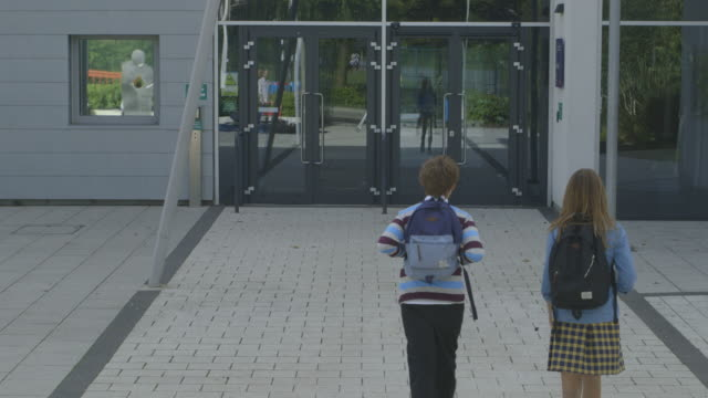 school children entering in school - entering stock videos & royalty-free footage