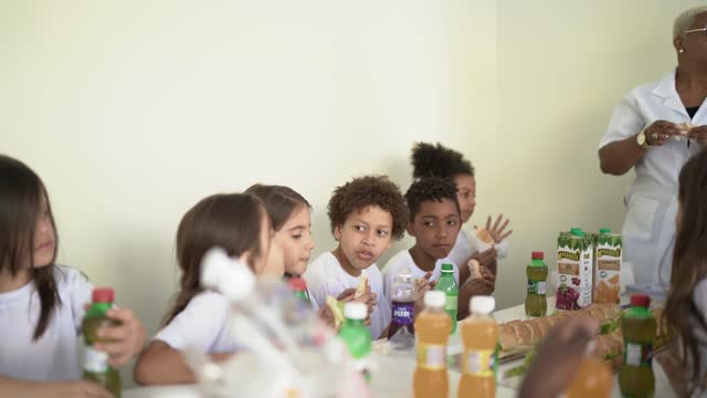 school children having lunch together at school - canteen stock videos & royalty-free footage