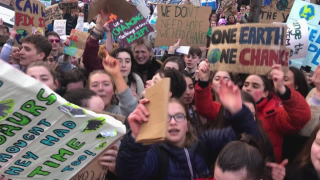 school children hold placards and shout slogans as they participate in a protest outside the scottish parliament on march 15 2019 in edinburgh... - education stock videos & royalty-free footage