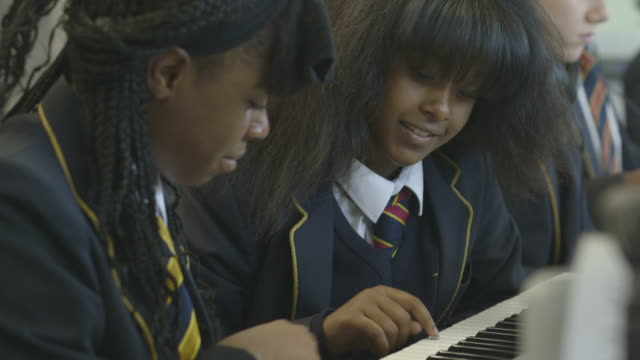 school children learning music - schoolgirl stock videos and b-roll footage