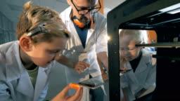 School children make the robot printing it on a 3D printer.