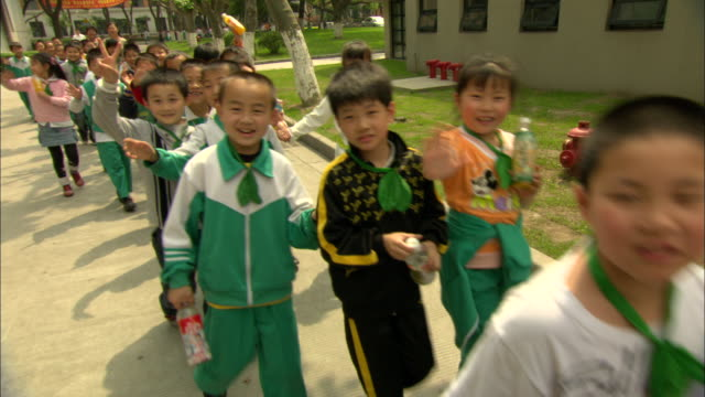 ms pan school children on field trip to campus of tongji university, shanghai, china - schoolgirl stock videos & royalty-free footage