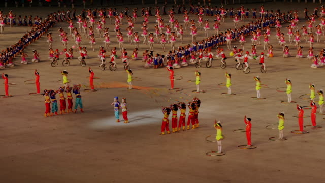 school children performing rope jumping and amazing synchronised gymnastics during mass games in pyongyang, north korea, dprk. medium shot - north korea stock videos & royalty-free footage