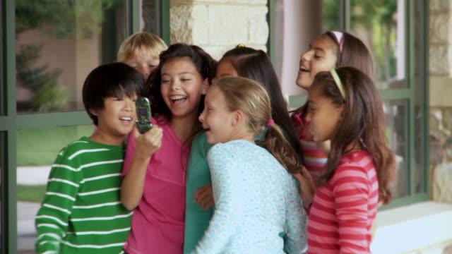 vídeos de stock e filmes b-roll de ms, td, school children (8-13) photographing themselves with mobile phone camera, richmond, virginia, usa - criança em idade escolar
