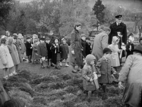 school children place flowers at william wordsworth's memorial fountain in cockermouth to celebrate the poets centenary - centesimo anniversario video stock e b–roll