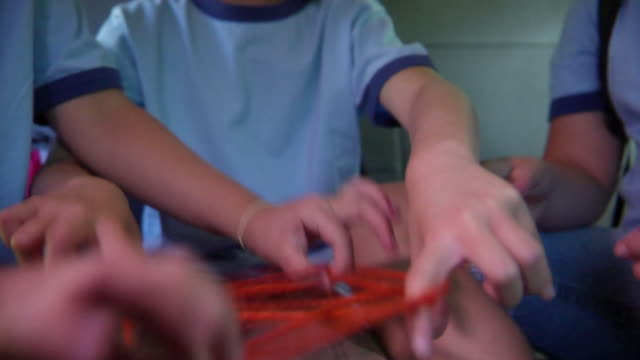cu, selective focus, school children (8-11) playing cats cradle sitting in van, bovina, new york state, usa - cat's cradle stock videos & royalty-free footage