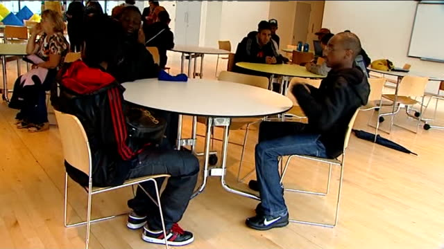 school children receive gcse results; michael barry interview sot various shots young black male students sitting around hall waiting on exam results... - マイケル バリー点の映像素材/bロール