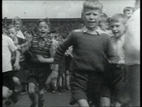 school children running through playground - childhood stock videos & royalty-free footage