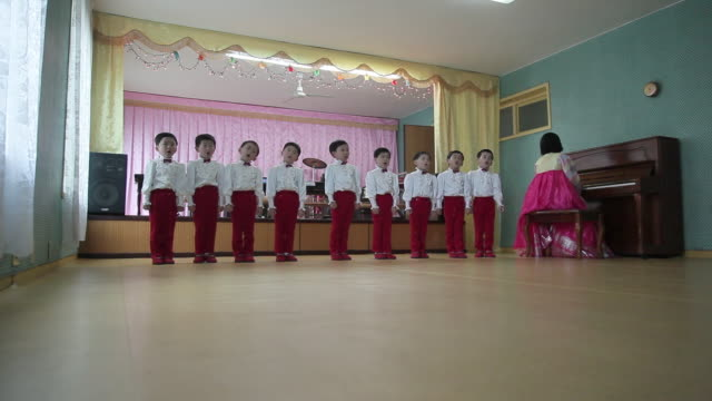 School children sing and perform in the Children's Palace in Pyongyang, North Korea.