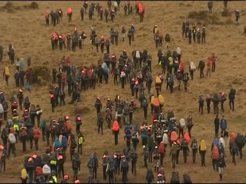 school children take part in annual 30 mile hike known as the ten tors challenge - マイル点の映像素材/bロール