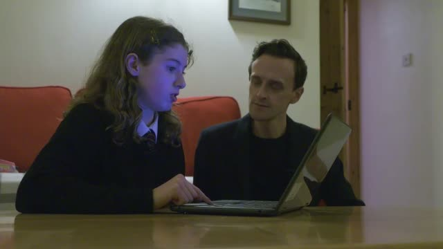 school children to go on strike in climate change protest; scotland: fort william: int holly chatting to reporter whilst looking at computer sot - channel 4 news stock videos & royalty-free footage