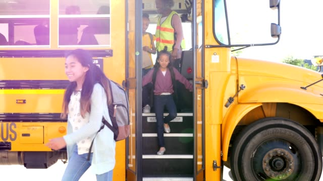 school children unload school bus - getting out stock videos & royalty-free footage