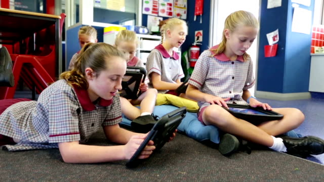 school children using tablet computers in the classroom - classroom stock videos & royalty-free footage