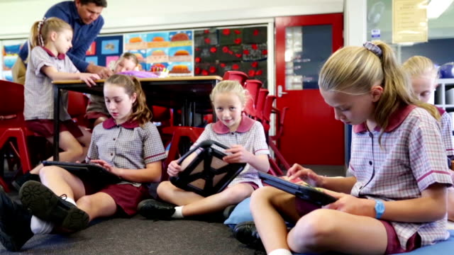 school children using tablet computers in the classroom - modern stock videos & royalty-free footage