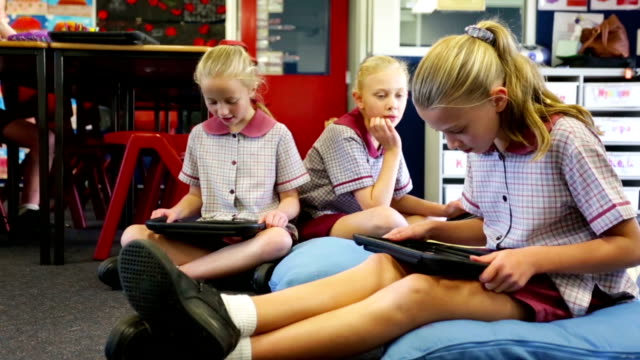 school children using tablet computers in the classroom - back to school stock videos & royalty-free footage