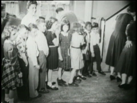 school children wait in line to receive the polio vaccine from a doctor - polio stock videos & royalty-free footage