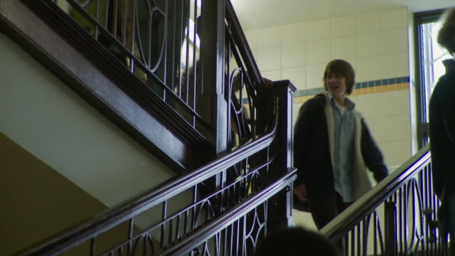 MS LA School children (12-17) walking up and down stairs, Cazenovia, New York, USA